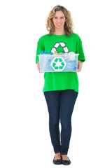 Cheerful environmental activist holding recycling box