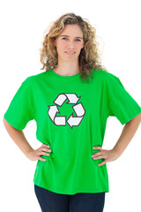 Environmental activist wearing green shirt with recycling symbol