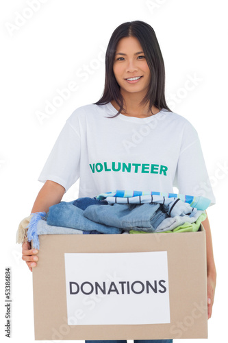 Happy woman carrying donation box