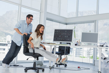 Designers having fun with a swivel chair