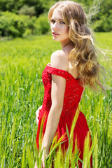 beautiful blonde girl in green field