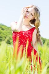 beautiful blonde girl in green field