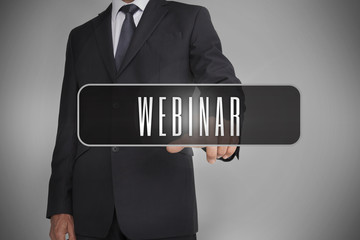 Businessman selecting label with webinar written on it