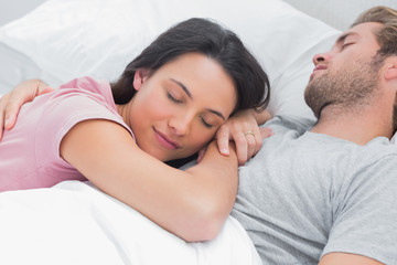 Woman sleeping on her husbands chest