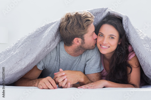 Handsome man kissing his wife