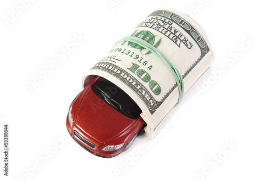 car in roll of dollars