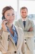 Pretty businesswoman having phone conversation