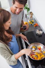 Woman cooking bell pepper
