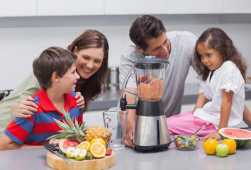 Family using a blender