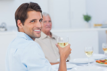 Attractive man holding a glass of white wine