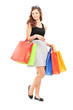 Full length portrait of a beautiful young woman posing with shop
