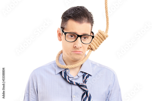 Depressed man executing a suicide with a rope