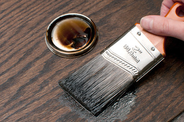Painting wood in brown with brush