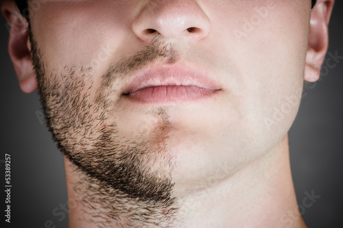 portrait of a handsome man with a shaved half his face