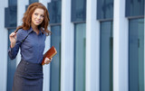 Young happy women or student on the property business background