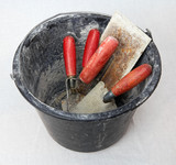 Bucket with masonry tools