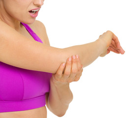 Closeup on woman with elbow pain