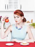 Woman choosing between healthy food and cake