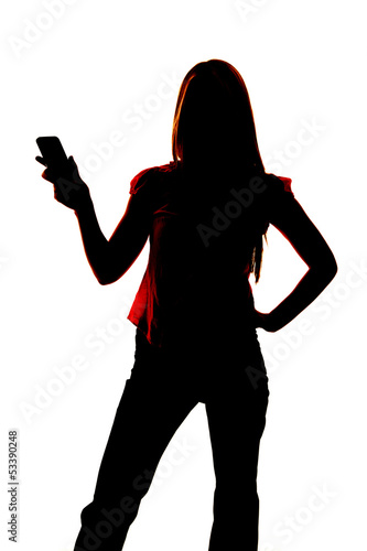 Silhouette of woman holding out cell phone.