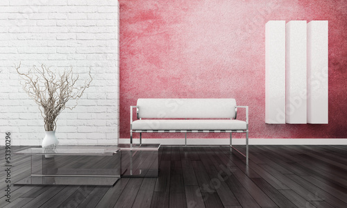 White sofa in front of red wall with bricks
