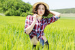Beautiful  woman in hat on summer meadow