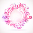 Pink round frame with design elements.