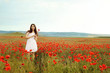 teen girl in poppy field