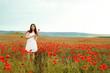 teen girl in poppy field