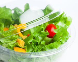 fresh vegetables salad in plastic container
