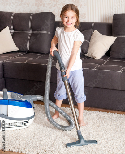 little girl cleaning the room