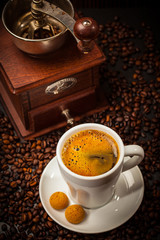 Espresso cup with coffee mill
