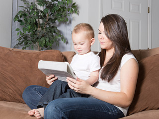 Woman and toddler learning together on wireless tablet device