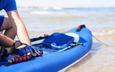 man preparing his kayak at the beach