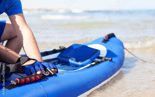 man preparing his kayak at the beach