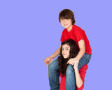 Boy riding on his sister