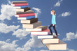 child or teen climbing a stair case of books