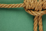 Rope with marine knot  on the green background
