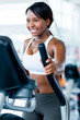 Fit woman exercising at the gym