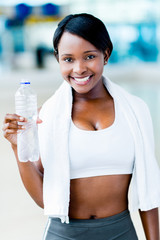 Gym woman with a bottle of water