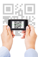 Female hands scanning qr code with smartphone, isolated