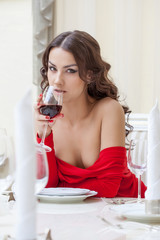 Sexy brunette posing with glass of wine