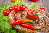 Sausage with tomatoes and hot peppers