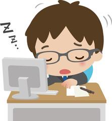 デスクワーク中に居眠りする男性