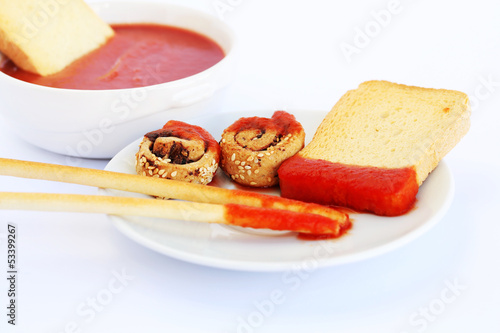 Rusks with sesame seeds, bread sticks and sauce