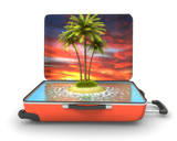 Open suitcase with tropical island at evening