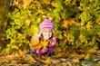 Autumn portrait of a little girl