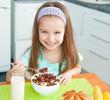 little girl eating her breakfast
