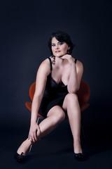 Beautiful woman in armchair