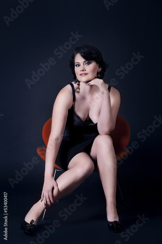 Beautiful woman in armchair