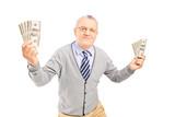 Happy senior man holding money bankontes
